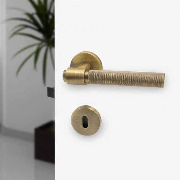 Door handle - Antique bronze - HELIX - Elegant industrialism