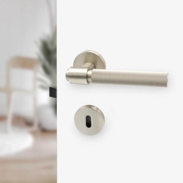 Door handle - Brushed steel - HELIX - Elegant industrialism