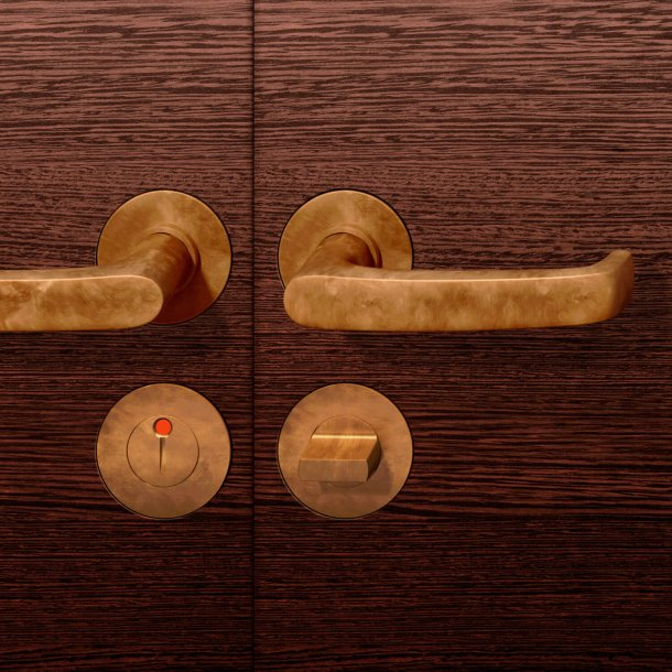 Door handle with WC lock - bronze dark patinated waxed - model 10 1045