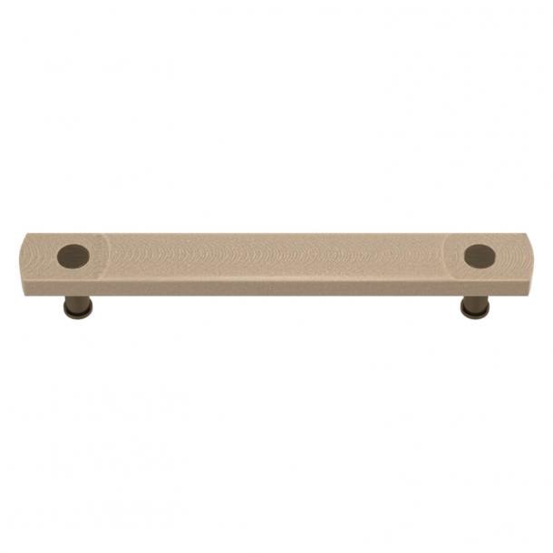 Uchwyt do mebli - Turnstyle Designs - Amalfine w kolorze piaskowym / Antyczny mosiądz - Model E3700