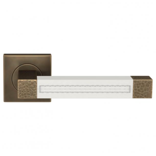 Klamka do drzwi - Turnstyle Design - Biała skóra / Mosiądz polerowany na ciemny - Model HR1025