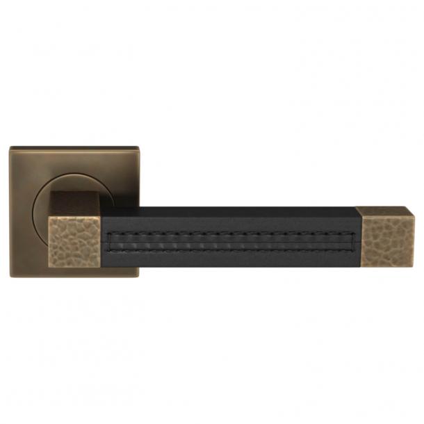 Turnstyle Design Dørgreb - Black leather / Burnished brass - Model HR1025