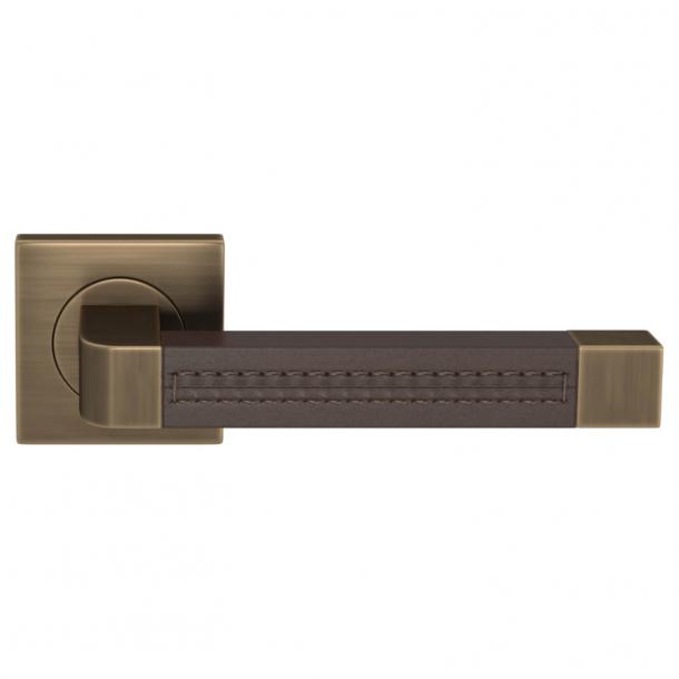 Turnstyle Design Door handle - Chocolate leather / Antique brass - Model R1941