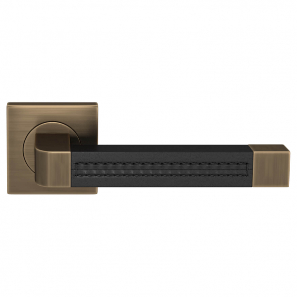 Turnstyle Design Door handle - Black leather / Antique brass - Model R1941