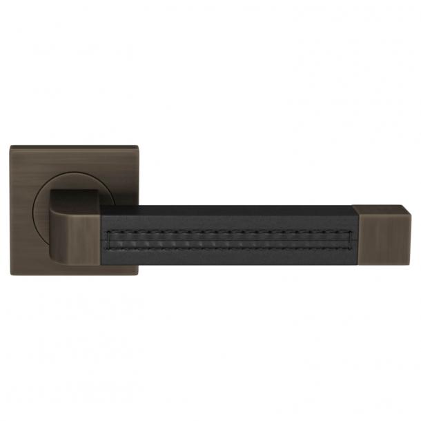 Turnstyle Design Door handle - Black leather / Vintage patina - Model R1941