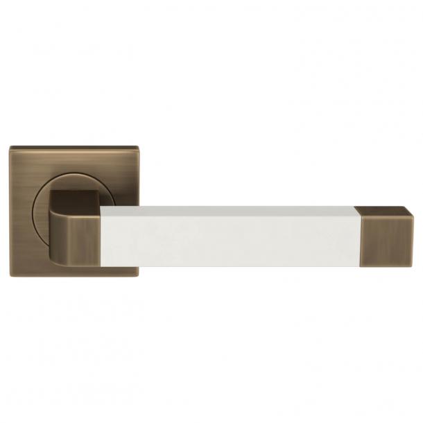 Turnstyle Design Door handle - White leather / Antique brass - Model R2030