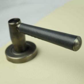 Turnstyle Designs - Combination of leather door handles